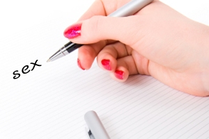 Woman hand with pen and paper.